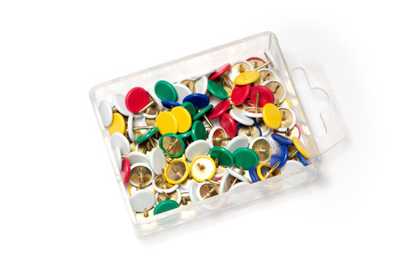 A lot of colorful tumb tack in the plastic box.