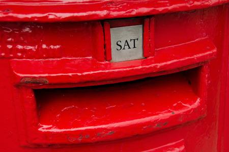 pillar box: Detail of red metal british post box. Stock Photo