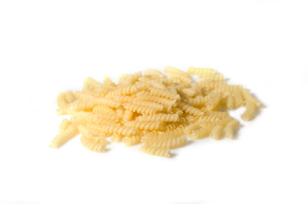 pastes: Heap of fusilli pastes isolated on white background.