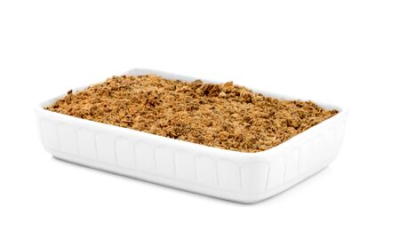 apple crumble: Apple crumble in a white ceramic pan isolated on white background.