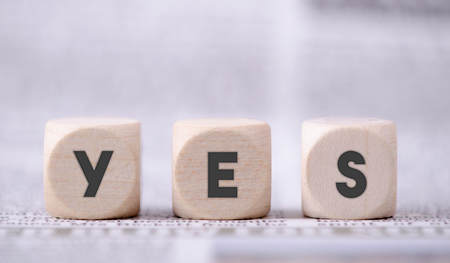 small articles: Yes word written on three wooden dice. Stock Photo