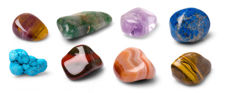 rock stone: Eight colorful gems isolated on white background. Stock Photo
