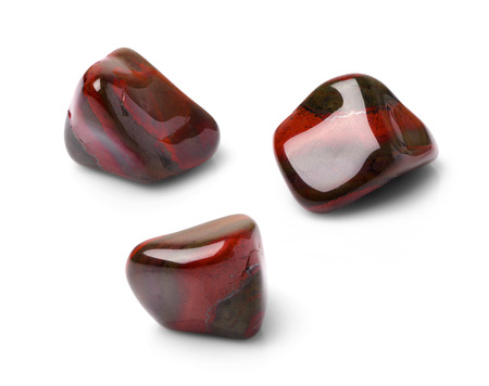 chatoyant: Red tiger eye polish gem shot from three points of view.