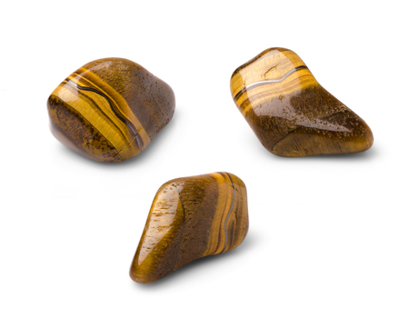 chatoyant: Tiger eye polished gem shot from three points of view isolated on white background. Stock Photo