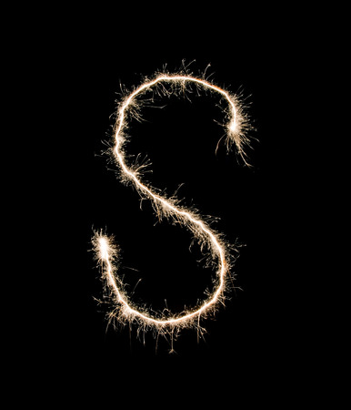 s curve: Letter S drew with spakrs on a black background.