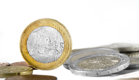 oncept: Heap of european currency coins isolated on white background, money c oncept. Stock Photo