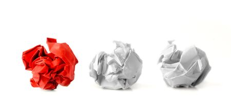 scrunched: Red paper ball next to two white ones as a symbol of difference and variety of society and ideas.