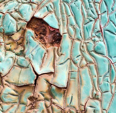 aging process: Texture of blue cracked paint on metal surface, aging process