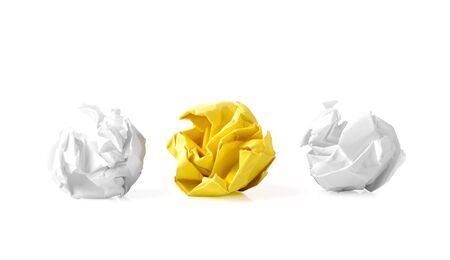 paper ball: Yellow paper ball between two white ones as a symbol of difference and variety of society and ideas.