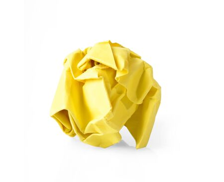 scrunched: Yellow wrinkled paper ball isolated on white background, symbol of recycling and wasting our resources.