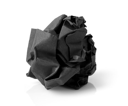 paper wad: Black wrinkled paper ball isolated on white background, symbol of recycling and wasting our resources. Stock Photo