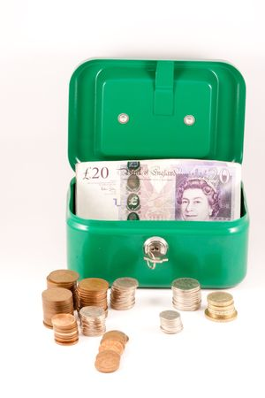 Savings box with UK cash. Stock Photo
