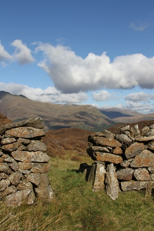trecking: Traditional dry stone wall provides access to national park land.