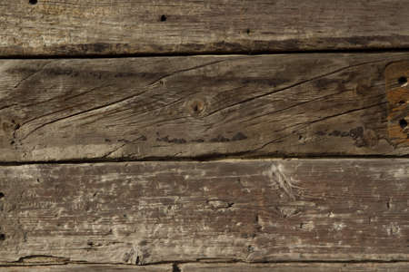 Reclaimed railway sleepers stacked up with holes and grain providing a background. Stock Photo
