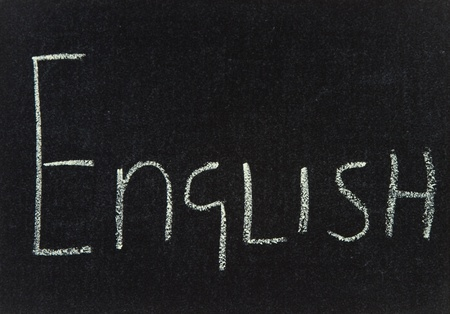 The word English written in chalk on a black board.