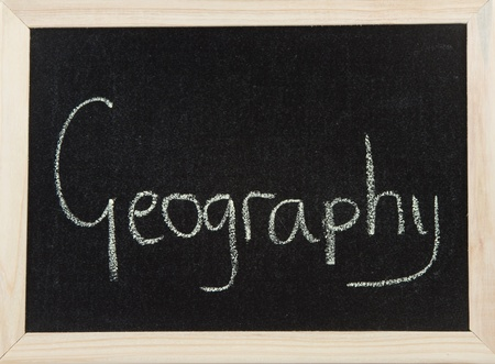 A black board with a wooden frame and the word 'GEOGRAPHY' written in chalk. Stock Photo - 9945565