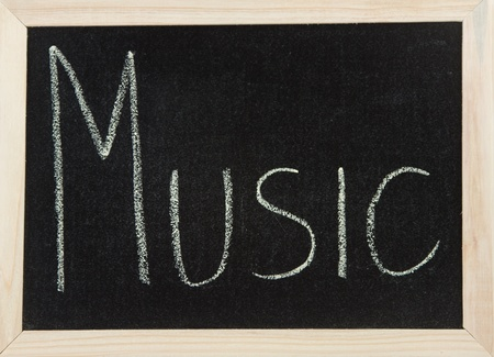A black board with a wooden frame and the word MUSIC written in chalk.