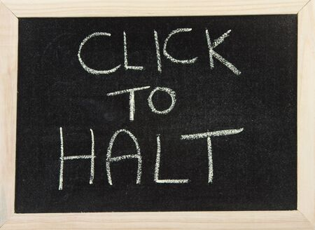 A black board with wooden frame and the hand written words in chalk 'click to halt'. Stock Photo - 10055875