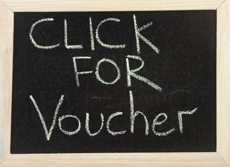 A black board with wooden frame and the hand written words in chalk 'click for voucher'. Stock Photo - 10055879