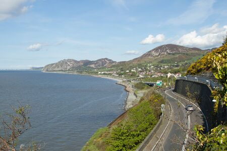 The A55 at Penmaenmawr, North Wales, UK, looking across the sea towards Llandudno.
