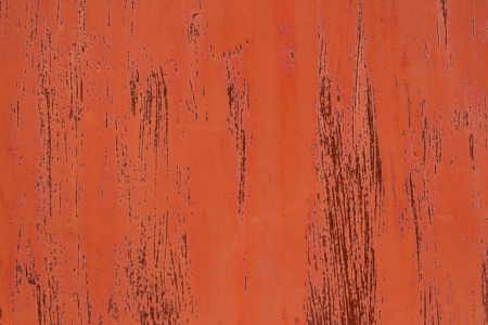 metal base: A metal base with orange paint and streaks over rust red.
