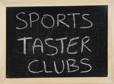 taster: A blackboard with a wooden border with the words SPORTS TASTER CLUBS written by hand in white chalk. Stock Photo