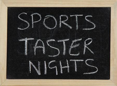 taster: A blackboard with a wooden border with the words SPORTS TASTER NIGHTS written by hand in white chalk.