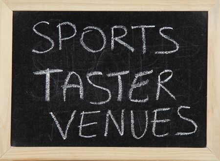 venues: A blackboard with a wooden border with the words SPORTS TASTER VENUES written by hand in white chalk.