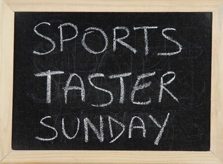taster: A blackboard with a wooden border with the words SPORTS TASTER SUNDAY written by hand in white chalk.