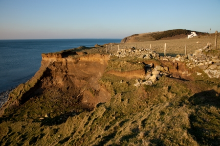The coast path ends at a landslip and crumbling stone wall above, West Shore, Trefor, Lleyn peninsular, Wales, UK. Stock Photo - 18142163