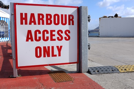 A sign with a white background and the words HARBOUR ACCESS ONLY written in red.