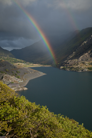 nant: A view across Llyn Peris to Nant Peris and the Llanberis Pass with a double rainbow. Llanberis, Snowdonia national park, Wales, UK