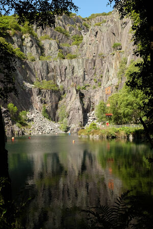 modern rock: A view of the Glyn Vivian slate quarry, Llanberis, Wales, UK. An industrial heritage site and modern rock climbing venue.