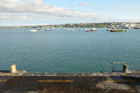 A view from the quayside wall out across the moorings of Holyhead marina, Anglesey, Wales, UK.