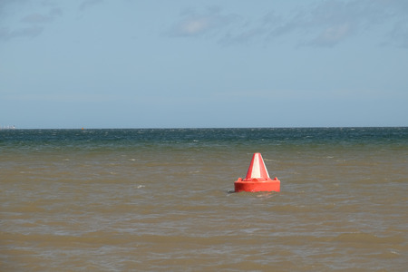 safe water: A red and white, Bedford buoy, safe water, inlet day marker on the sea. Stock Photo