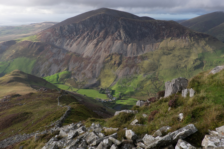 snowdonia: A stone wall leads down a spur to a valley with the imposing feature of Mynydd Mawr stands prominent. Snowdonia, Gwynedd, Wales, UK Stock Photo