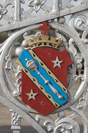 sceptre: The coats of arms of Bangor city, Gwynedd, Wales, UK. Attached to grey painted ironwork. Stock Photo