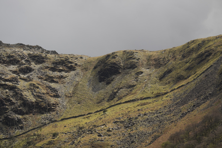 The Lady of Snowdon. Face profile feature on the flank of a steep hill in Snowdonia near Llanberis, Gwynedd, Wales, UK