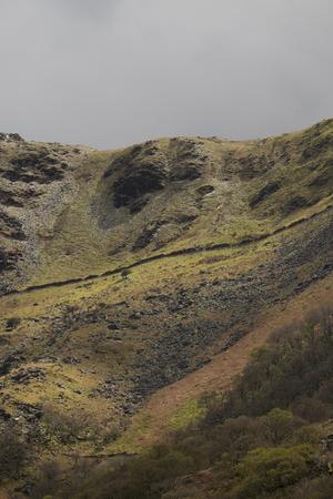 Lady of Snowdon. Face profile on a steep hillside in Snowdonia near Llanberis, Gwynedd, Wales, UK.
