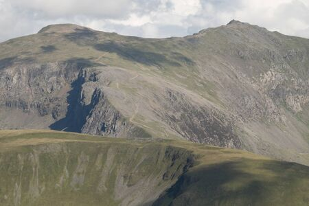 flank: The west flank of Snowdon with the winding ranger path over Clogwyn Ddr Arddu leading to the summit. Snowdonia, Wales, UK. Stock Photo
