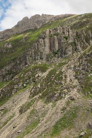 snowdonia: The mountainside crag Dinas Cromlech in the Snowdonia National Park, Llanberis Pass, Wales, Uk. Stock Photo
