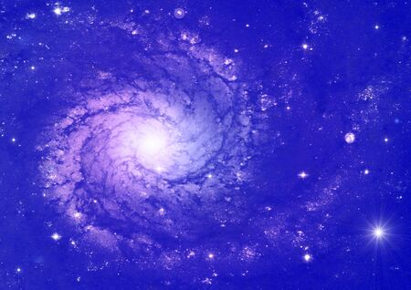 Spiral galaxy against blue space, nebula and stars in deep outer space photo