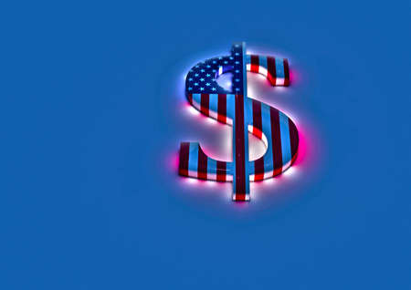 color registration: Dimensional sign of the American dollar in color national flag of USA. Stock Photo
