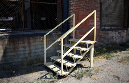 A Metal Staircase Stands Outside Of An Abandoned Warehouse Building In Los  Angeles. Stock Photo