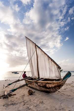 Dhow on the beach in Zanzibar. Stock Photo