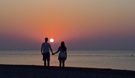 young couple is enjoying the sunrise