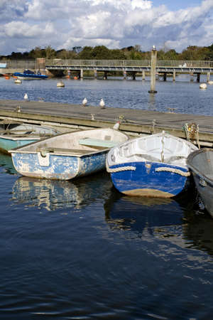 dinghies: Small dinghies moored in a british fishing village.