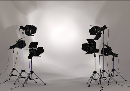 Studio lighting equipment with copy space of your image or message in a spotlight on white wall environment Imagens