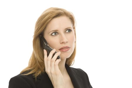 A businesswoman in a suit uses a cell phone against a white backround Stock Photo - 1229033
