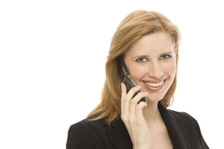 A businesswoman in a suit uses a cell phone against a white backround Stock Photo - 1229034